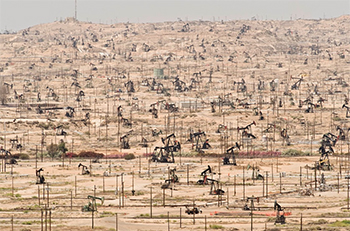 """I don't understand why when we destroy something created by man we call it vandalism, but when we destroy something created by nature we call it progress."" —Ed Begley, Jr. Depleting oil fields are yet another symptom of ecological overshoot; Kern River Oil Field, California, U.S.; © Mark Gamba/Corbis"