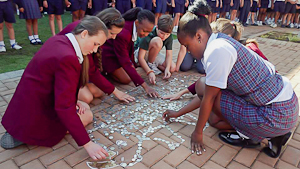 Carter and Olivia visiting the Trinity House School in South Africa